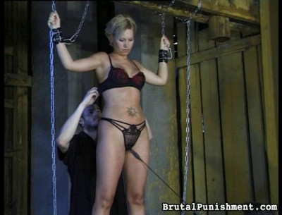 Submits to a tit-whipping and more but manages to smile in spite of the pain
