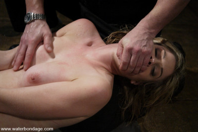 Fayth gets hogtied in a deserted military shower and hosed down!