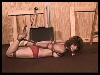 Bound and Gagged - The Money Pit Scene 2 - Lorelei is Hogtied