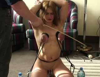 Pretty Blonde Takes Clips and Whips