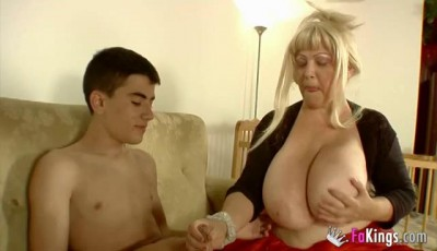 Busty Granny seized upon the young cock
