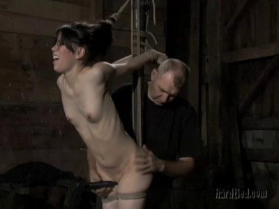 He fucks her rough with a dildo and whacks her with a cane