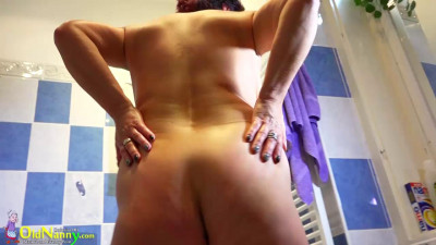 Mature using dildo in shower