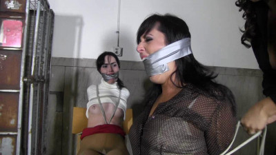 She turns the weapon on Dixie and goes to work tying her up stuffing her mouth