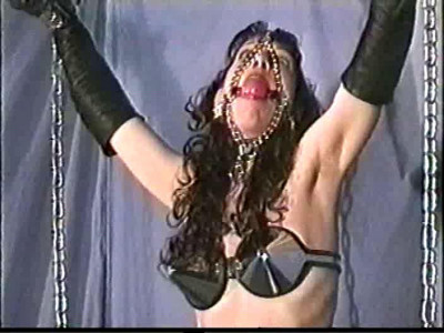 I tie a rope to Lisas crotchrope and tie it off overhead as well very tightly