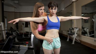 Going the Extra Mile: Strict Trainer Dominates Lesbian Gym Slut