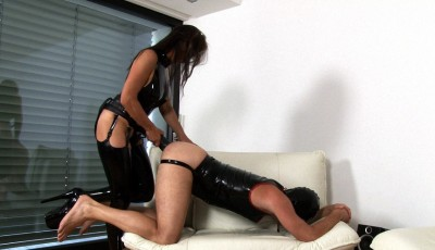 Latex Dominatrix Gets Her Strapon