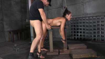 Busty brunette Ava Dalush chained and shackled in strict bondage