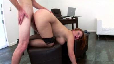 Alluring big boobed redhead rides massive cock