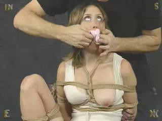 When she is not kneeling like a slut on the floor, she is usually bound to something being