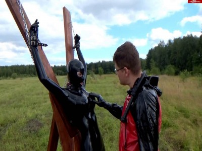 Chained girl in latex two dildo gets punished
