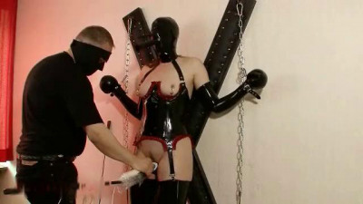 Submissive girl in latex is suspended... (2014)