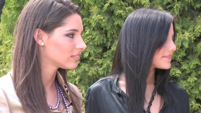 Two stunning brunettes finger fuck each other outdoors