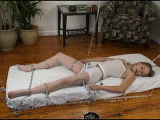The second scene she is lief bound and gagged on a table
