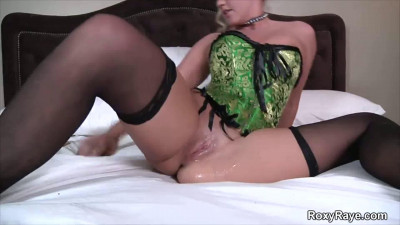 Blonde in Green Corset Pussy Stretching