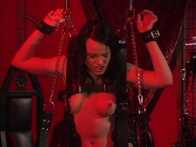 Mistress plays with two slaves whip and dildo