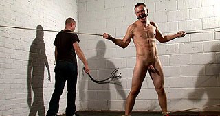Tied naked and ballgagged, arse flogged