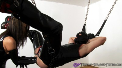 Dominatrix ass fucks slave with fist and dildo