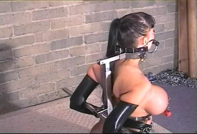 See this lady as she struggles hard to escape from being bound