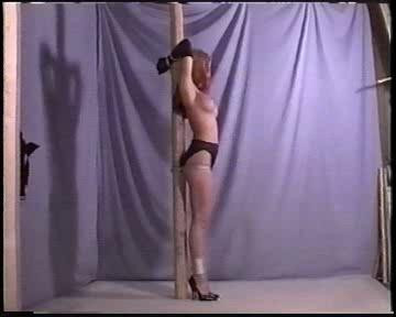 Heres a pretty hot lady, naked and bound by a horny master