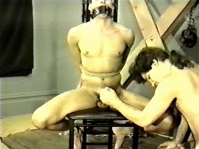 Bound tighter than a drum head, the slave struggles to please his master