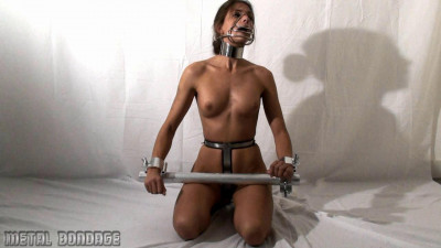 MB059-Romy is belted, clamped, and muzzled