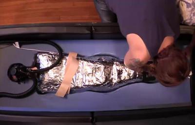 Mercy West - Mummy Encasement