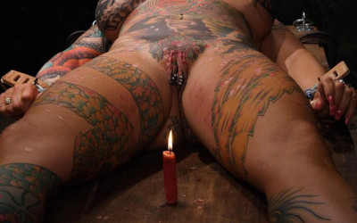 Cruelly BDSM with wax and clothespins