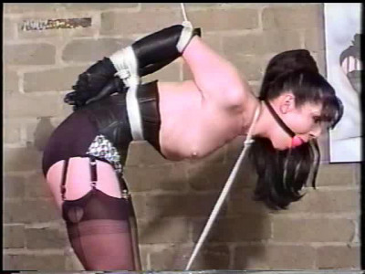 This poor lady here is bound in ropes
