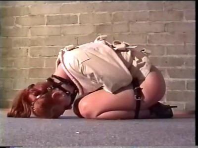 Devonshire Productions-Her last scene features a hogtie so tight she can't move at all