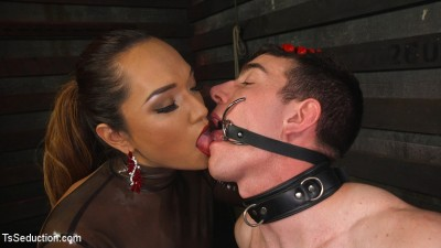 Latex Clad Domme Torments Hard Cocked Slaveboy