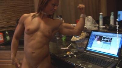 Sexy Female Bodybuilder in kitchen