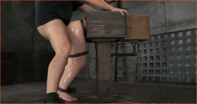 Amy Faye bound in a wooden box