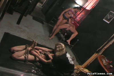 This Young Lady Is So Helpless. She's Naked And Bound In Rope By A Captor
