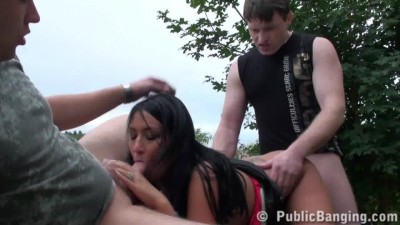 Two guys fuck a pretty girl on the hill