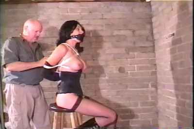 She's gagged and tied up and the only way out is to try her best to loosen the rope