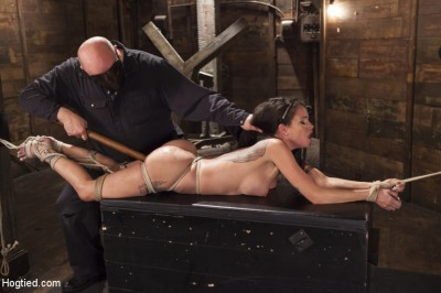Big tit Brunette caught in brutal bondage.