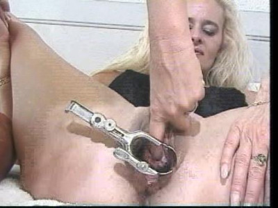 Lesbians playing with gynecological mirror