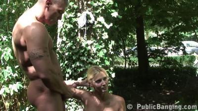 Beefy guy fucks blonde in the garden
