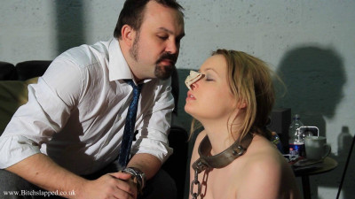 Petgirl learns to wear heavy collar and handcuffs that are connected together with chains