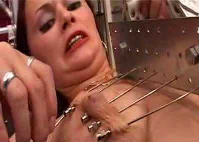Tits torture with big long needles