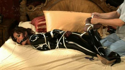 In this scene the lovely girl has been tied up gagged, and left to struggle on her bed