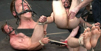 Bound with head and feet strung up to the ceiling
