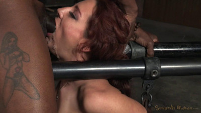 Savannah Fox chained to a sybian and deepthroated