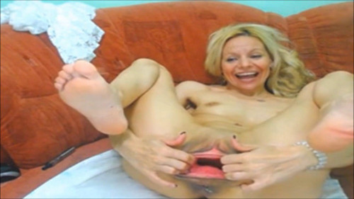 Fisting and Dildo Blonde plays with a huge dildo