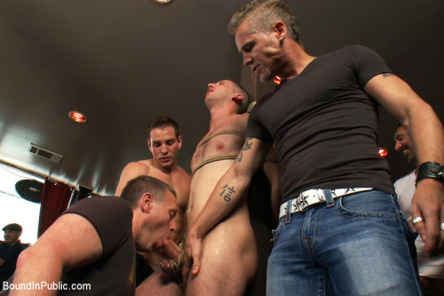 Gay BDSM Muscle stud uses and abuses his boy in front of a horny lunch crowd.