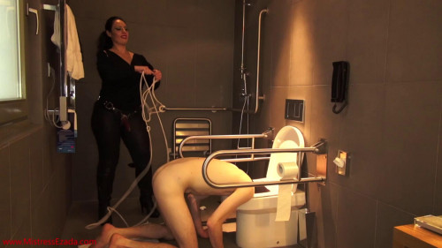 Femdom and Strapon Mistress Ezada Deepthroated, then fucked and ruined with his head in the toilet (2014)