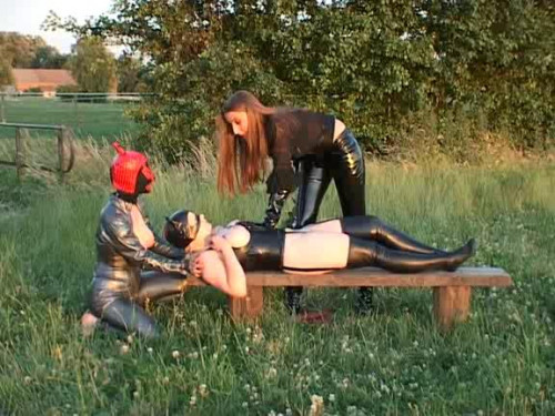 Femdom and Strapon Latex baby milk on the nature Man on a bench