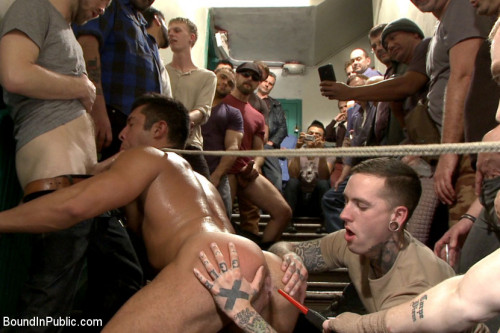 Gay BDSM Muscled hunk tormented and gang banged in a stairwell full of horny men