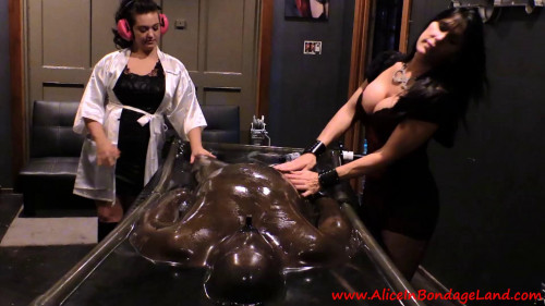 Femdom and Strapon Be Careful What You Wish For - Rubber Vacbed FemDom Foursome